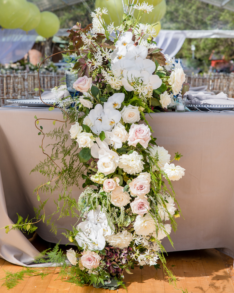 love, hope, flowers, lhflowers, wedding flowers, flowers, Sydney, Sydney florist, christening, centennial park, big balloons, white orchids, table centre pieces, long table centrepieces, cascading flowers, draping flowers off table,